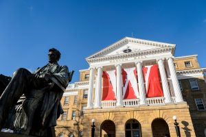 W banners hang from the columns of Bascom Hall at the University of Wisconsin-Madison during winter on Dec. 9, 2016. In the foreground, at left, is the Abraham Lincoln statue.